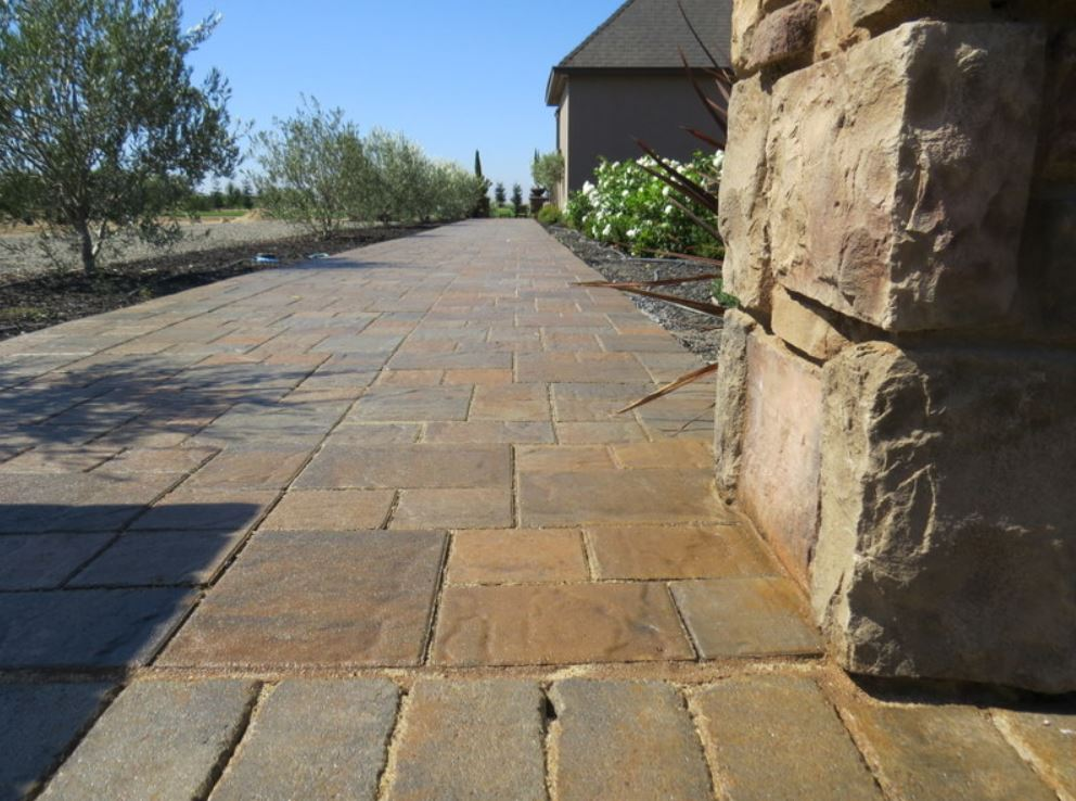 this image shows concrete fremont masonry stone pillar and stamped walkway